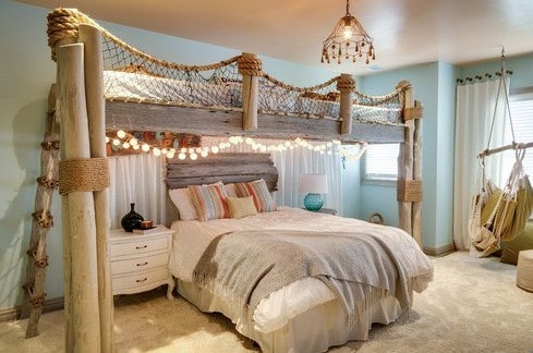 beach themed bedroom idea decor, with netting and cool theme.